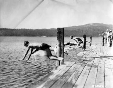 Image of Young Men Diving into Lake during CCC Carnival