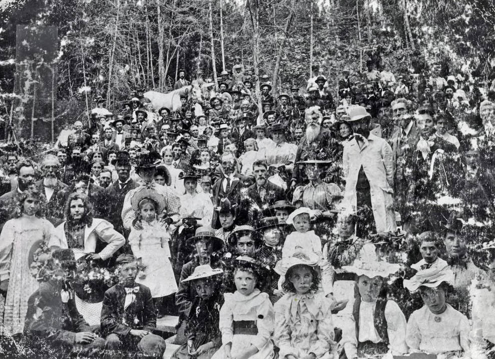 Group of people posed together in the woods. Grangeville?, Idaho.