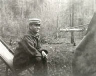 Image of Walter W. Slee seated in camp chair