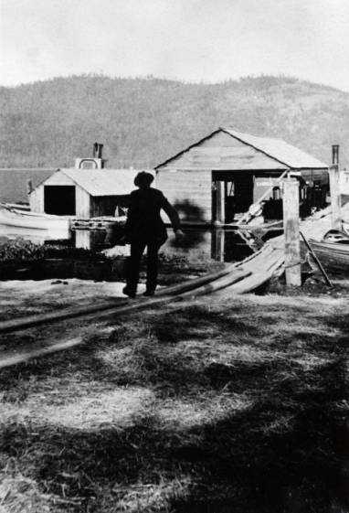 Image of Man walking up dock at the Coolin Marina, Coolin, Idaho.